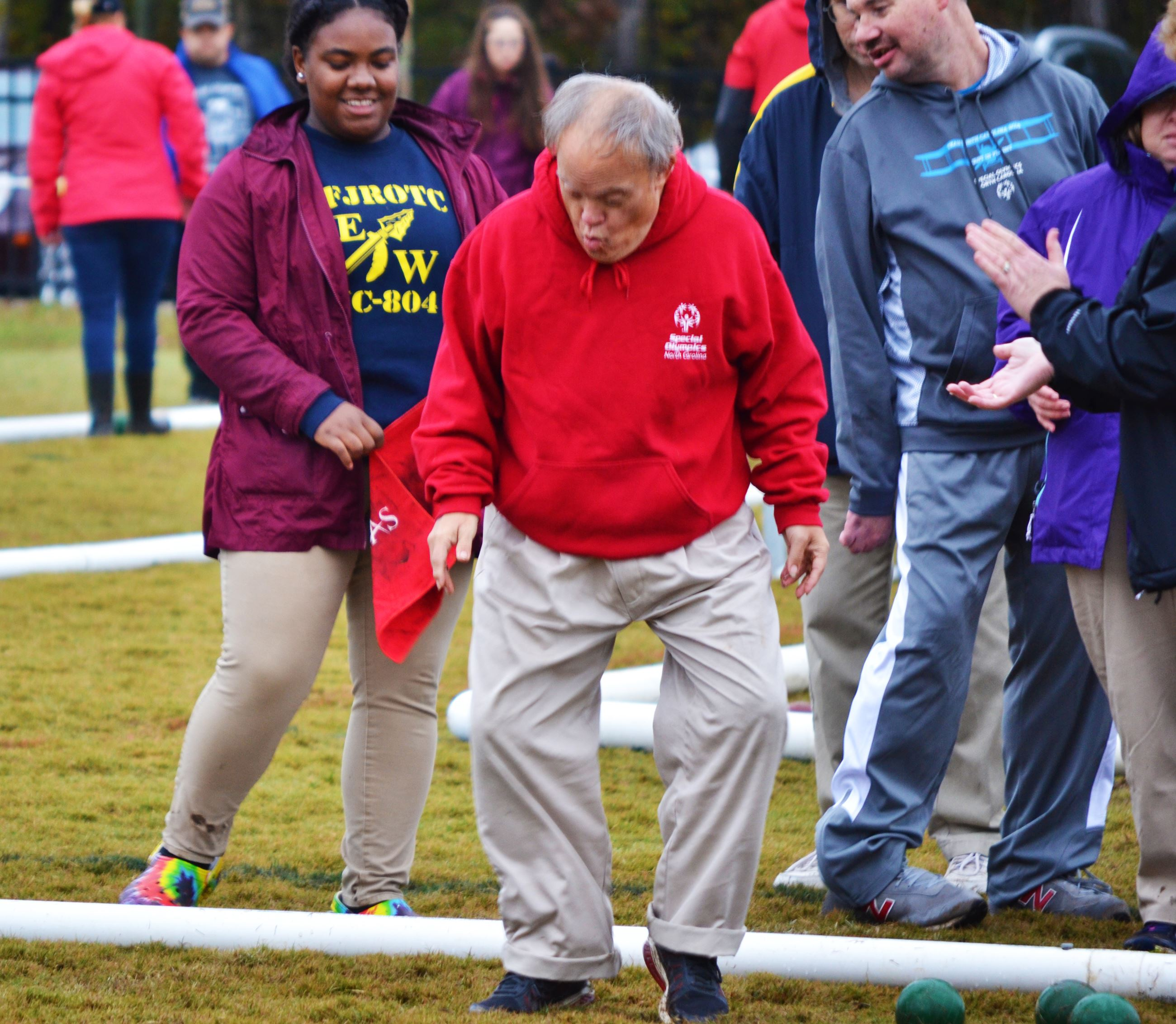 A Special Olympics athlete dances after a particularly good bowl during the bocce tournament at Ches