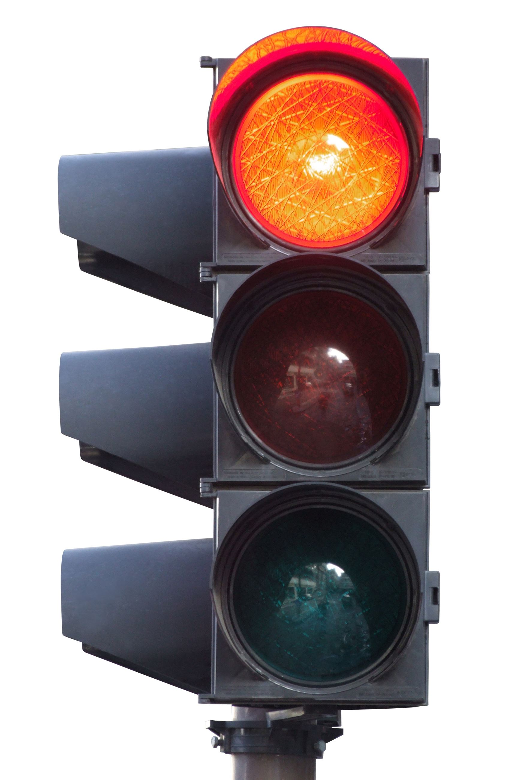 Black traffic light with the red light at the top lit