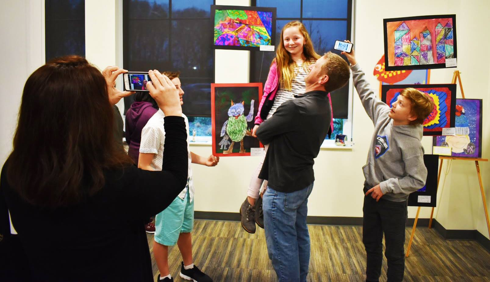 A family enjoys their young student artist&#39s work last year at the Indian Trail Town Hall.